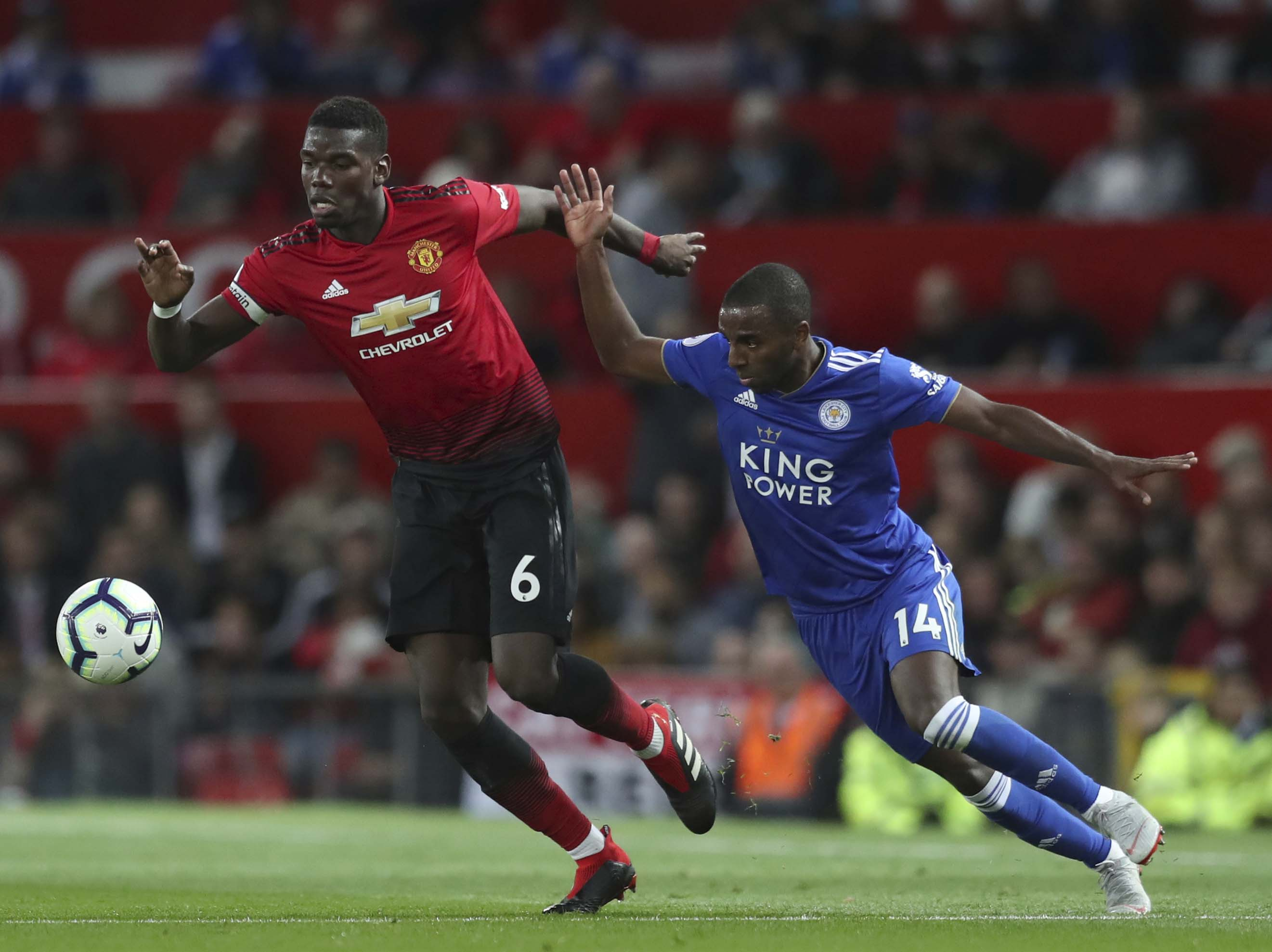 Manchester United's Paul Pogba (left) vies for the ball with Leicester City's Ricardo Pereira during the English Premier League soccer match between Manchester United and Leicester City at Old Trafford in Manchester, England on Friday.