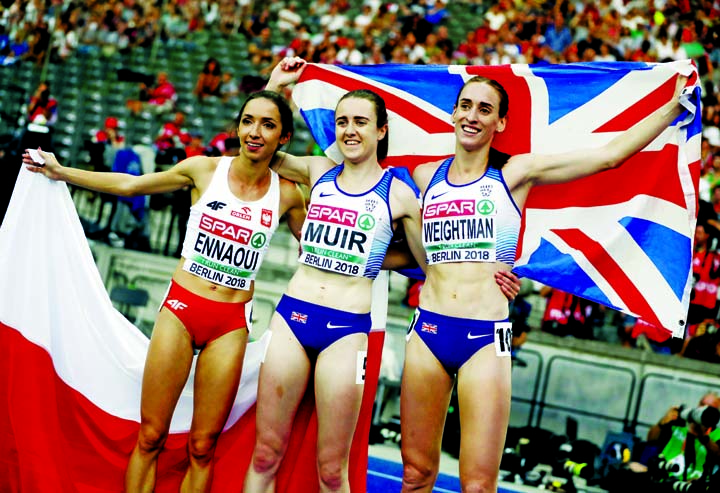 Britain's gold medal winner Laura Muir is flanked by Poland's silver medal winner Sofia Ennaoui (left) and Britain's bronze medal winner Laura Weightman after the women's 1500-meter final at the European Athletics Championships in the Olympic stadium in Berlin, Germany on Sunday.