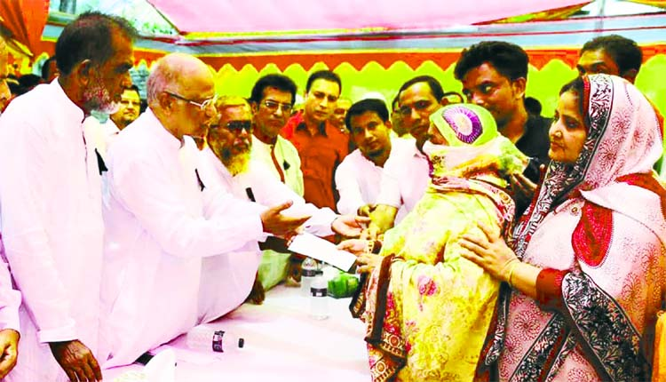 BNP Standing Committee Member Dr. Khondkar Mosharraf Hossain on behalf of Dr. Mosharraf Foundation handing over a cheque of Taka five lakh to mother of JCD leader Jewel Prodhan Raihan who was killed in road accident at the foundation office in the city on Monday.