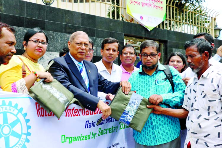 The Secretary Forum 2018-19 of Rotary International District 3281, Bangladesh distributing raincoats among the rickshaw pullers at Karwan Bazar in the city on Monday.