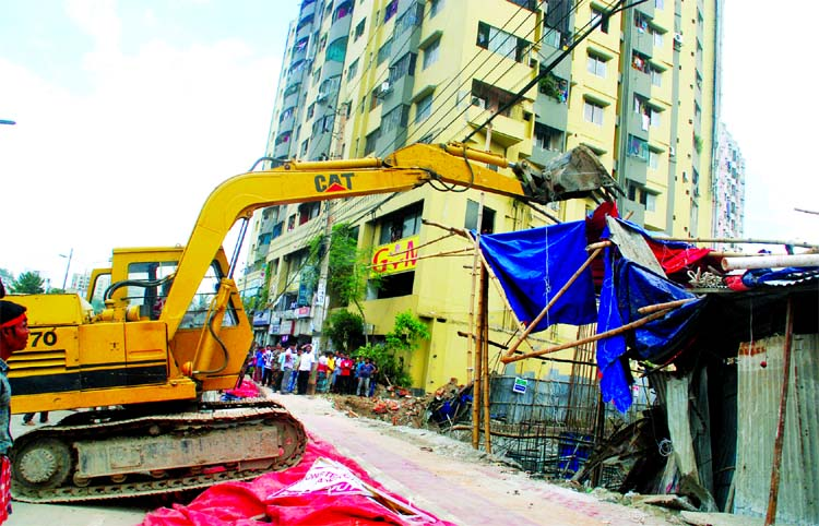 Roads and Highway authorities in a drive evicted illegal establishments at Darussalam Road at Mirpur in city on Tuesday.