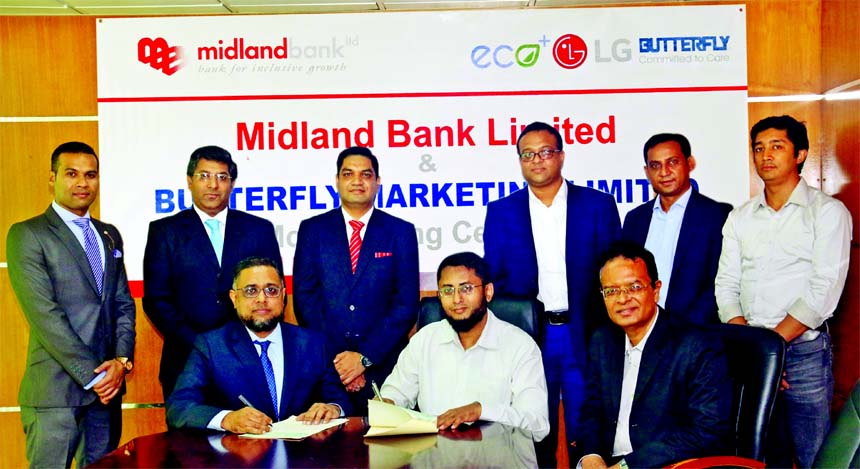 Md. Ridwanul Hoque, Head of Retail Distributions of Midland Bank Limited and Mahbub-Ur-Rahman Shajib, Director (Operations) of Butterfly Marketing Limited (an importer, manufacturer and marketeer of wide range consumer electronics, home appliances and energy products), exchanging an agreement signing document at the Bank's head office in the city recently. Under the deal, Visa Credit Cardholders of the Bank will enjoy EMI facility up to 12 months at 0 percent interest while purchasing electronic goods from the company outlets in the country. Senior officials from both organizations were also present.