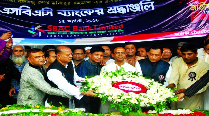 South Bangla Agriculture and Commerce (SBAC) Bank Ltd Managing Director Md Golam Faruque, EC Committee Chairman M Moazzem Hossain, Additional Managing Director Mostafa Jalal Uddin Ahmed and senior officials placing floral wreaths at the portrait of Bangabandhu Sheikh Mujibur Rahman on the occasion of National Mourning Day at the city's Dhanmondhi-32 on Wednesday.