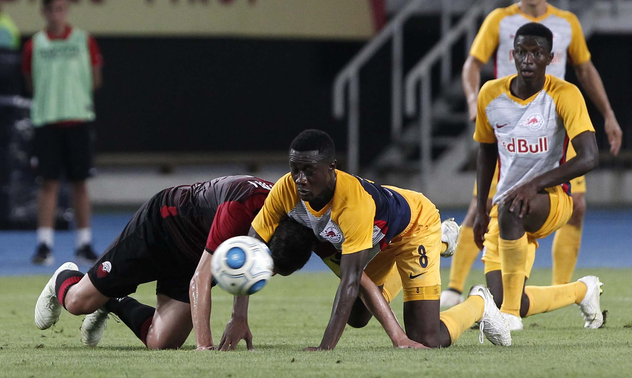 Salzburg's Diadie Samassekou (center) vies for the ball with Shkendija's Armend Alimi (left) during the Champions League third qualifying round, second leg soccer match between Shkendija and Red Bull Salzburg, at Philip II Arena in Skopje, Macedonia on Tuesday.