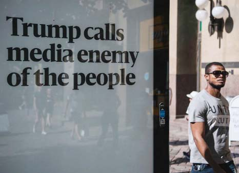 US newspapers hit back at Trump, defend free press