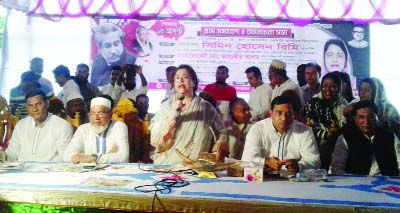 KAPASIA(Gazipur): Simin Hossain Rimi MP speaking at a village gathering on the occasion of the National Mourning Day as Chief Guest on Wednesday.
