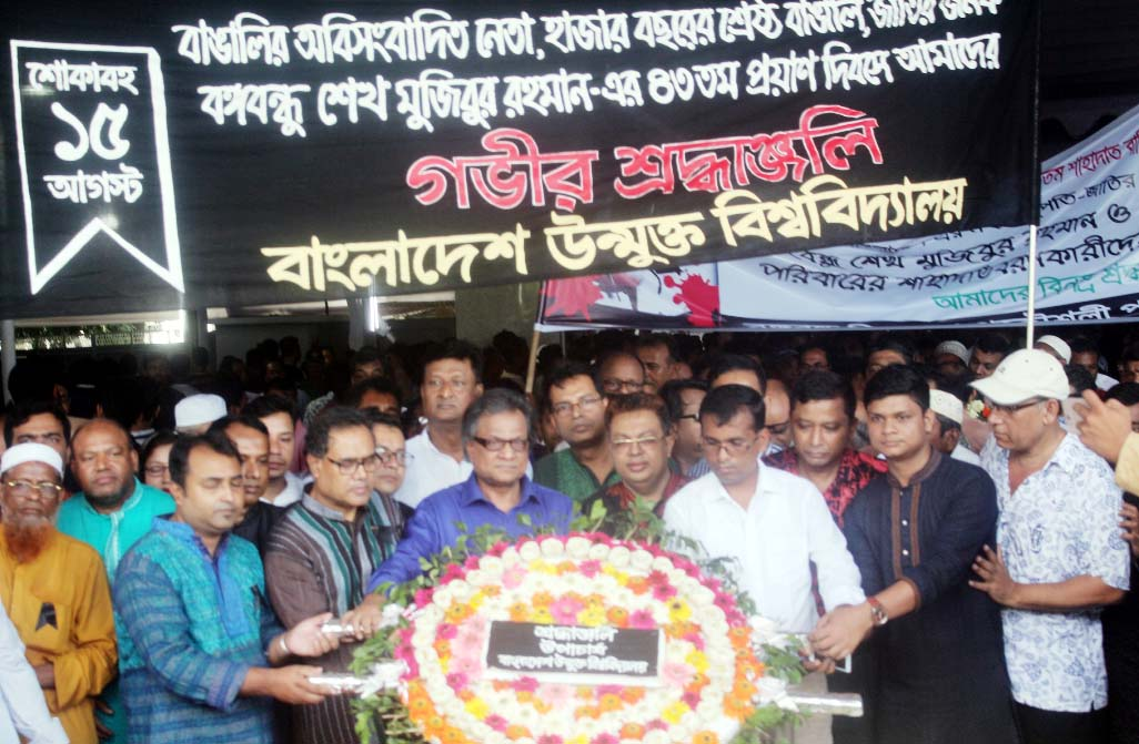 Vice Chancellor of Bangladesh Open University Prof Dr MA Mannan placing wreaths at the mural of Bangabandhu Sheikh Mujibur Rahman at 32 Dhanmondi in the capital observing the 43rd National Mourning Day on Wednesday.