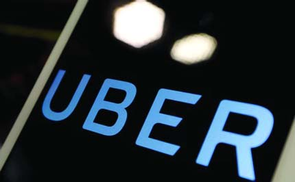 Uber narrows loss