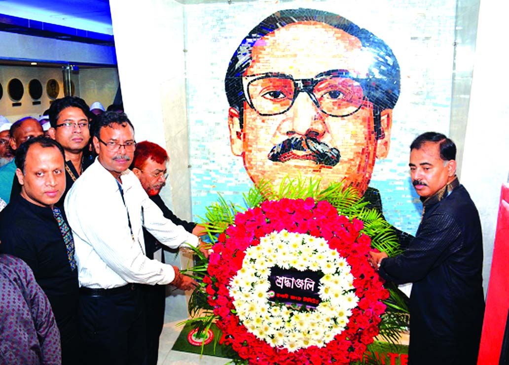 Md. Ataur Rahman Prodhan, Managing Director of Rupali Bank Limited, placing the floral wreaths at the portrait of Bangabandhu Sheikh Mujibur Rahman on the occasion of National Mourning Day at the city's Dhanmondhi Road No. 32 on Wednesday. Deputy Managing Director Mohammad Jahangir Alam, General Manager Kaisul Haque, Arun Kanti Paul, Saida Khatun, Jakia Sultana, Khan Iqbal Hossain and other employees of the bank were present at that time.