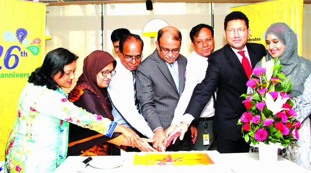 Managing Director of Eastern Bank Limited Ali Reza Iftekhar, inaugurating its 26th anniversary programme by cutting a cake at its corporate head office in the city on Thursday. Additional Managing Director Hassan O. Rashid and other senior officials of the Bank were also present.