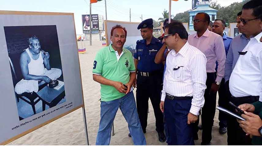 Reputed photojournalist Pavel Rahman organised a photo exhibition on Bangabandhu Sheikh Mujibur Rahman at Labonno Point in Cox's Bazar Beach yesterday. Chattogram Divisional Commissioner Abdul Mannan and Cox's Bazar Deputy Commissioner Md Kamal Hossain seen visiting the exhibition.