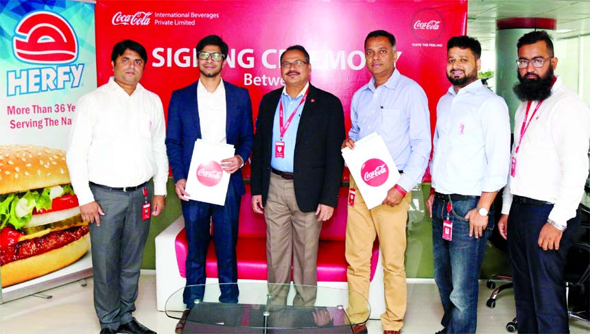 Coca-Cola Company owned bottler International Beverages Private Limited (IBPL) Managing Director Tapas Kumar Mondal and international fast food franchise Herfy's operations Director Imtiaz Faisal, poses for a photograph after signing an agreement at IBPL's head office in the city recently. Under the deal, Cola-Cola beverages will be available in all Herfy outlets across Bangladesh. High officials from both the organizations were also present.