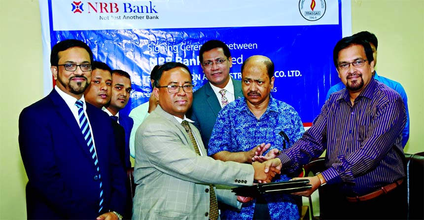A K M Kamal Uddin, Head of Corporate Banking of NRB Bank Limited and Mahmudur Rab, General Manager of Titas Gas Transmission & Distribution Company Limited (TGTDCL), exchanging an agreement signing documents at TGTDCL head office in the city on Sunday. Under the deal, the Bank will collect Gas Bill of the company from customers through online. Senior officials from both the organizations were also present.