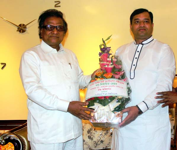 Prof Dr MA Mannan. Vice Chancellor of Bangladesh Open University presenting flower bouquet to Adv. Md Jahangir Alam, newly elected Mayor of Gazipur City Corporation at his residence in Gazipur on Tuesday.