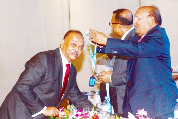 Commerce Minister Tofael Ahmed in a recent event in the city giving CIP card to Md. Azizul Islam, Chairman of Alif Group and former Chairman, Board of Trustees, Eastern University for his outstanding performance and contribution in the export sector.