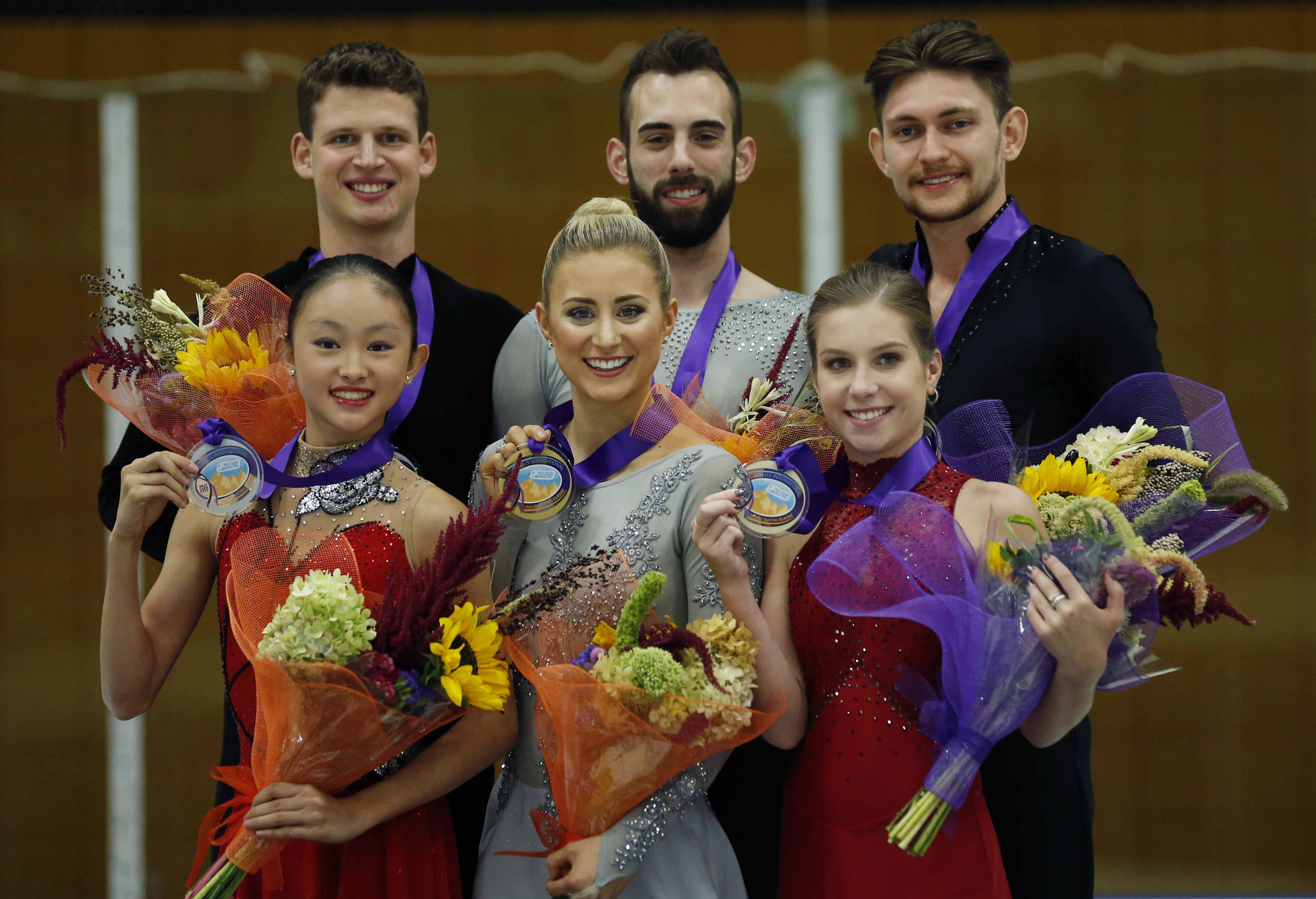 Pair's first place finishers Ashley Cain and Timothy Leduc (center) of the United States, shares the podium with second place finishers Audrey Lu and Misha Mitrofanov (left) of the United States and third place finishers Ekaterina Alexandrovskaya and Harley Windsor of Australia, at the U.S. International Figure Skating Classic on Friday in Salt Lake City.