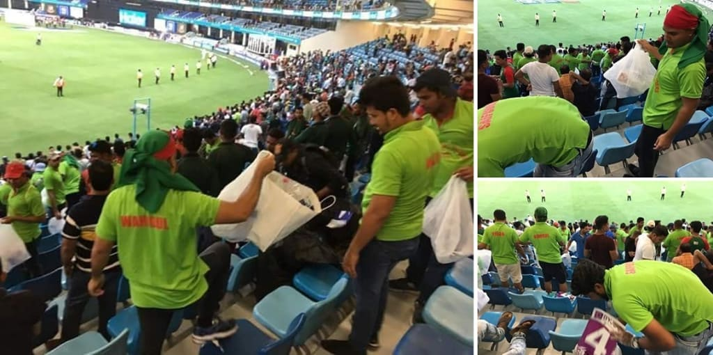 Bangladeshi supporters cleaning the galleries of the Dubai International Cricket Stadium for the spectators who arrived at the galleries to watch the opening match of the Asia Cup between Bangladesh and Sri Lanka on Saturday.