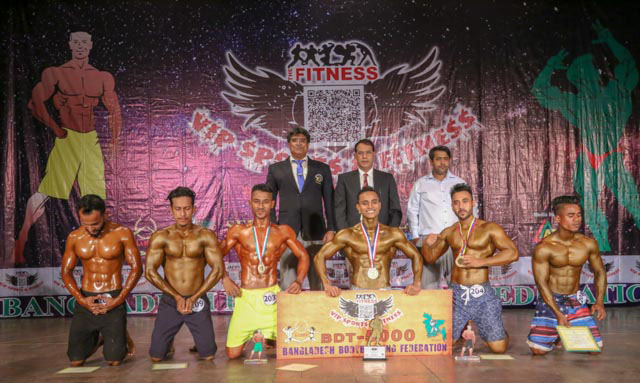 The winners of the VIP Sports & Fitness BABF Men's Volleyball Championship with the President of Bangladesh Bodybuilding Federation Major General (Retd) Subid Ali Bhuiyan and the guest and official of Bangladesh Bodybuilding Federation pose for a photo session at the Auditorium of National Sports Council on Sunday.