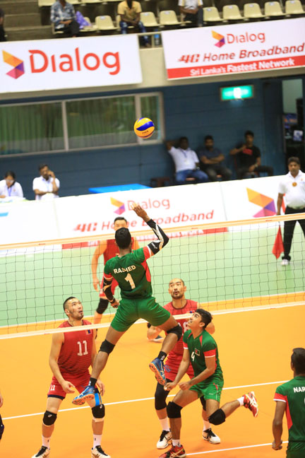 A moment of the match of the Asian Volleyball Challenge Cup between Bangladesh and Mongolia at Colombo in Sri Lanka on Monday. Bangladesh won the match by 3-1 sets.