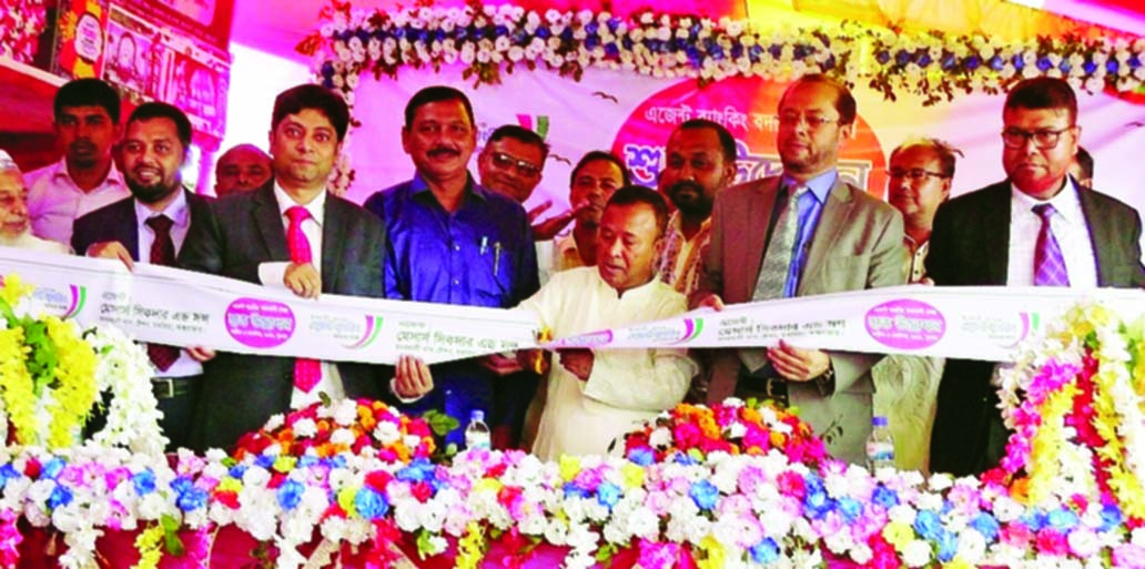 Jafar Alam, Chokoria Upazila Chairman, inaugurating an Agent Banking outlet of Islami Bank Bangladesh Limited as chief guest at Badarkhali Bazar of the Upazila recently. Mohammad Monirul Moula, AMD, Md. Nizamul Haque, EVP, Mohammed Shabbir, SVP of the Bank and local businessman were also present.