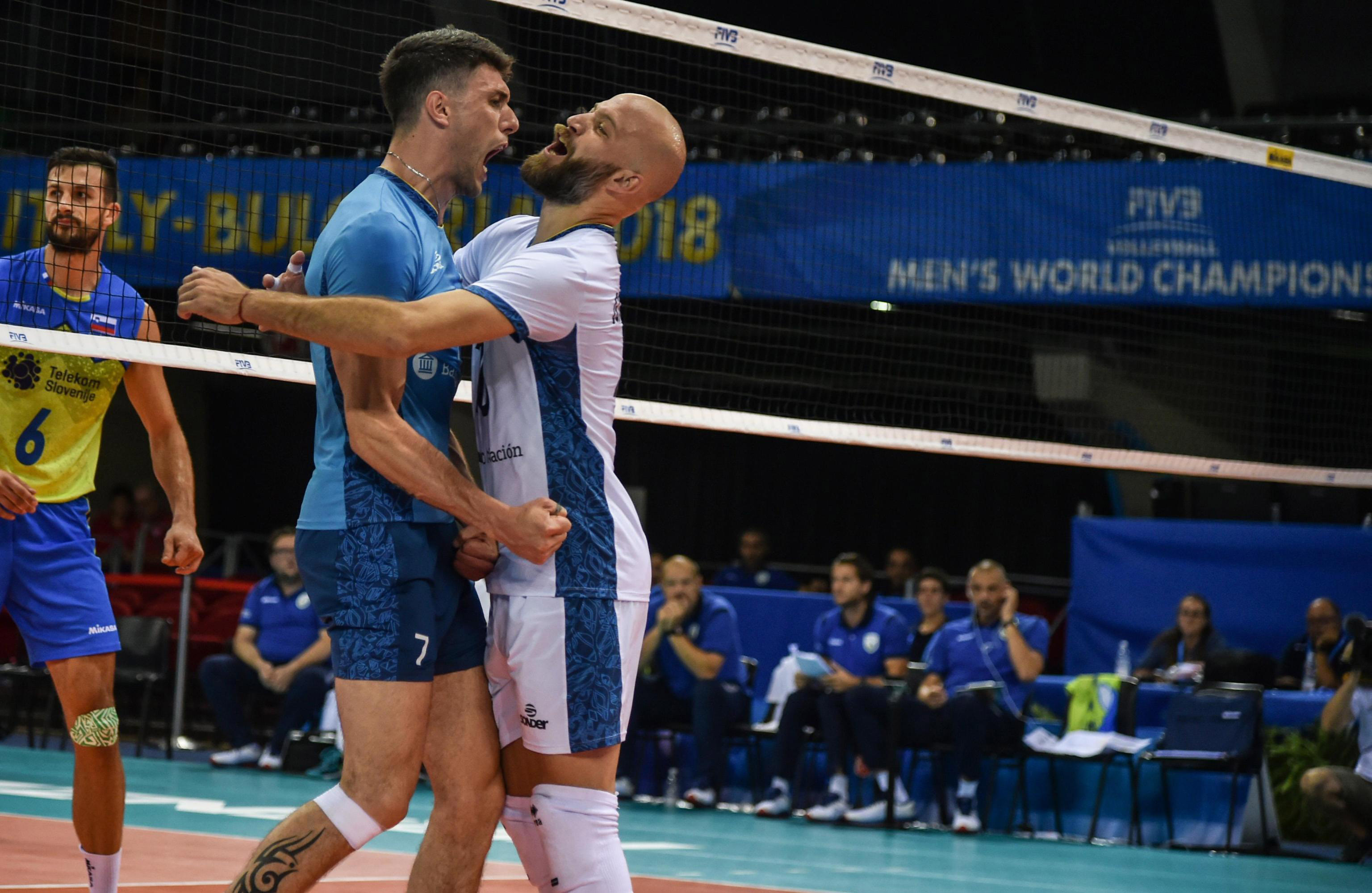 Argentina's Facundo Conte (left) and teammate Alexis Gonzalez celebrate during the Men's World Championships' volleyball match between Argentina and Slovenia, in Florence, Italy on Monday.