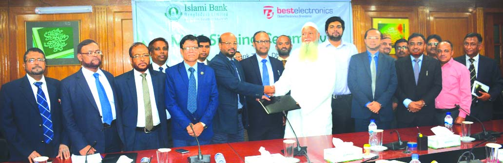Abu Reza Md. Yeahia, DMD of Islami Bank Bangladesh Limited and Md. Asaduzzaman, Managing Director of Best Electronics, exchanging an agreement signing document at the Bank's head office in the city recently. Under the deal, Khidmah (credit) cardholders of the Bank will enjoy EMI facilities in case of purchasing electronics goods from any outlet of the electronics company. Md. Mahbub ul Alam, CEO, Mohammed Monirul Moula, AMD of the Bank and other officials from both the organizations were also present.