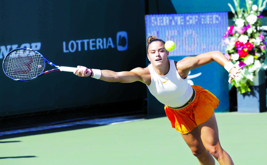 Maria Sakkari of Greece returns a shot to Kiki Bertens of the Netherlands during their semifinal match at the Korea Open tennis championship in Seoul, South Korea on Saturday.