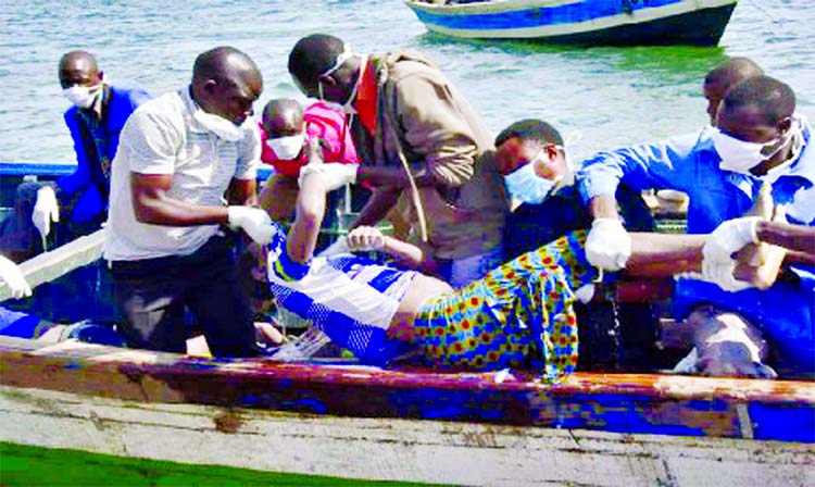 Rescuers retrieve a body from the water near Ukara Island in Lake Victoria, Tanzania on Friday.