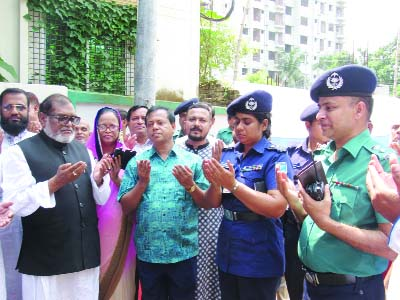 GAZIPUR:   Liberation War Affairs Minister AKM Mozammel Haque MP offering Munajat after laying down the foundation  stone of   Dhaka- Gazipur Multi-storey Trust Tower as Chief Guest on Saturday.