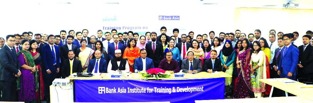 Mohammad Borhanuddin, Managing Director (CC) of Bank Asia Limited, poses for a photo session with the participants of a day-long training on 'Islamic Banking & Finance' organized by the Institute for Training & Development of the Bank at its head office in the city recently. Maulana Shah Mohammad Waliullah, Member Secretary of Shariah Supervisory Committee, Md. A Latif, EVP and AKM Mizanur Rahman, SVP of Islamic Banking Division of the Bank were also present.