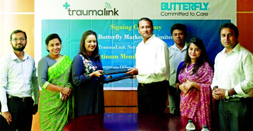 Mahbub-Ur Rahman Shajib, Director (Operations) of Butterfly Marketing Limited (BML) and Esha Chowdhury, Executive Director of TraumaLink, exchanging an agreement signing document at BML head office in the city on Monday. Senior officials from both the company were also present.