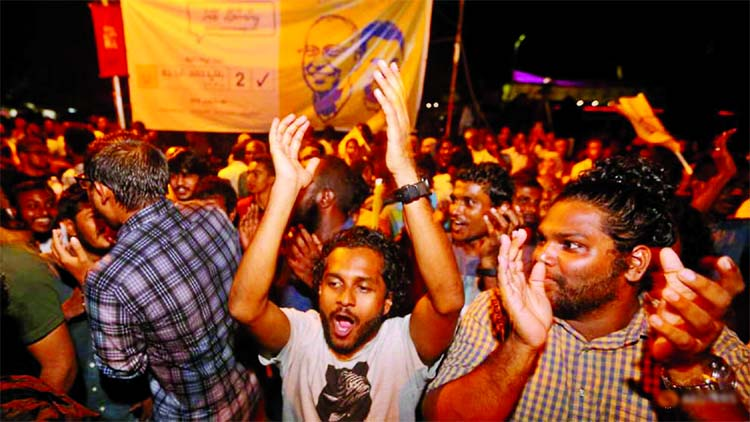 Supporters of Maldivian joint-opposition presidential candidate Ibrahim Mohamed Solih celebrate on the street at the end of the presidential election day in Male on Monday.