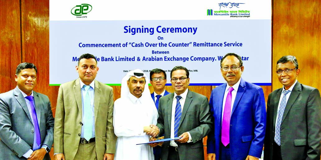 Kazi Masihur Rahman, Managing Director of Mercantile Bank Limited and Maqbool Habib Khalfan, Managing Partner of Arabian Exchange Company and former CEO of Doha Bank, Qatar, exchanging an addendum signing document at the Bank's head office in the city on Monday. Under the deal, beneficiaries of remittances sent through Arabian Exchange Company will be able to receive their remittances over the counter providing secret numbers at any branch of the bank along with the existing account credit facilities. Top officials from respective organizations were also present.