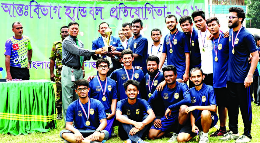 Members of Economics Department, the champions of the Inter-Department Handball Competition of Bangladesh University of Professionals (BUP) pose for photograph at the BUP Ground in the city on Tuesday.