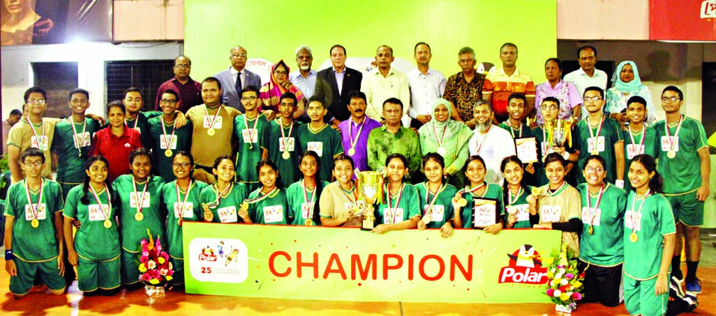 Sunnydale, the champions of the Boys' Group, Viqarunnisa Noon School & College, the champions of the Girls' Group of the Polar Ice Cream 25th School Handball Tournament with the guests and officials of Bangladesh Handball Federation pose for a photo session at the Shaheed (Captain ) M Mansur Ali National Handball Stadium on Tuesday.