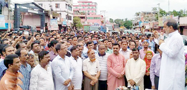 ABM Fazle Karim Chowdhury MP addressing a huge gathering at Munshirgata Party office premises at Raozan Sadar following  jubilant procession immediate after the  declaration of verdict on  August 21 grenade attack  on Wednesday.