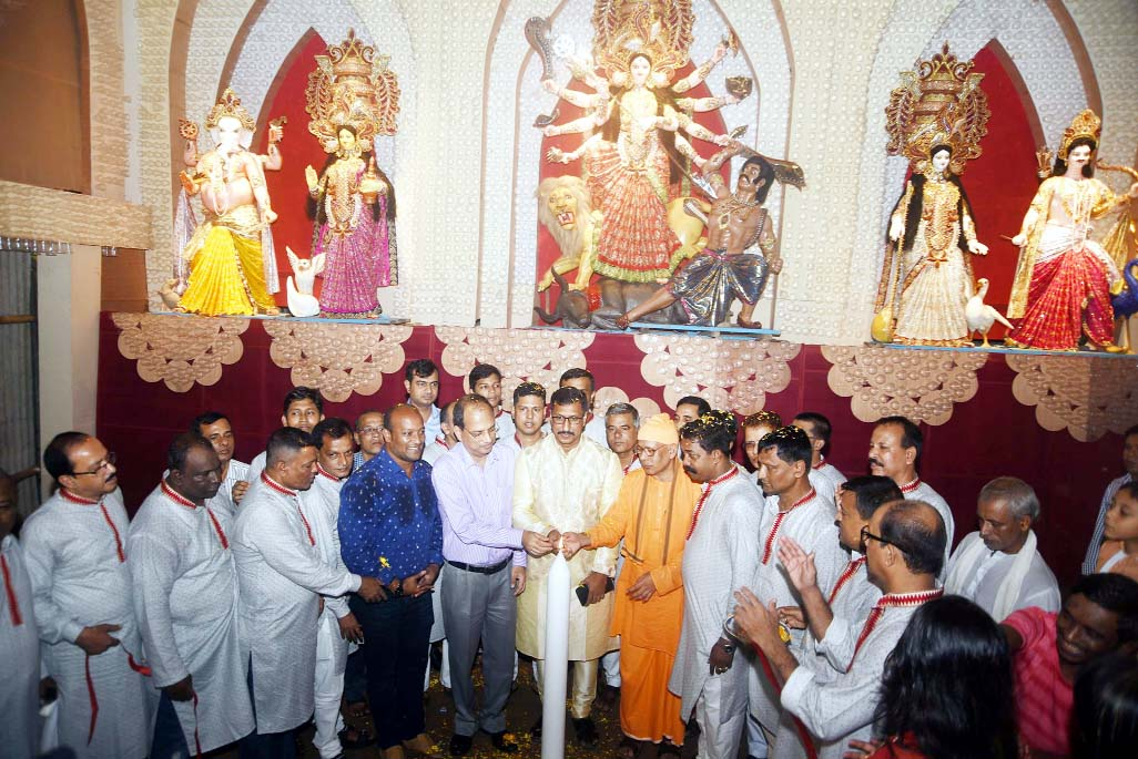 Dr Nisar Uddin Ahmed Monju, Acting CCC Mayor inaugurating Durga Puja programme in the Port City yesterday.