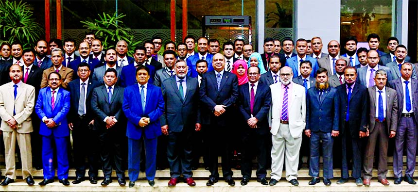 Syed Waseque Md. Ali, Managing Director of First Security Islami Bank Limited, poses for a photo session with the participants of a Quarterly Business Conference of its Dhaka and Rajshahi Zone at a hotel in the city on Thursday. Abdul Aziz, AMD, Md. Mustafa Khair, DMD, Divisional Heads and Branch Managers from two zones of the Bank were also present.