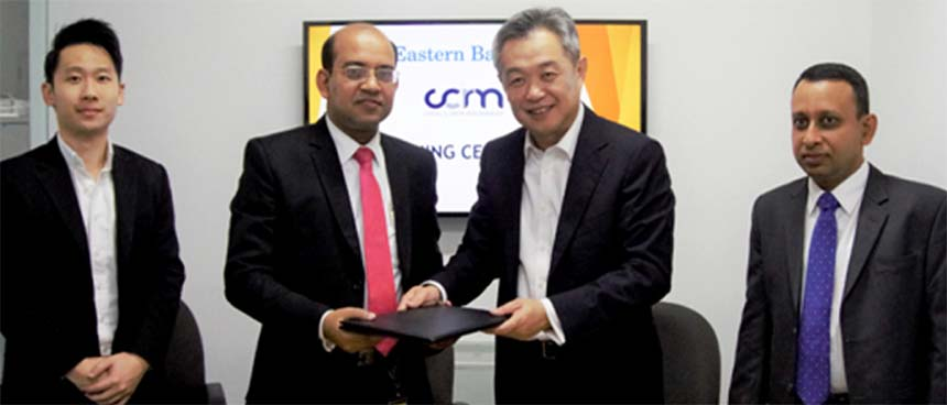 Md. Obaidul Islam, Head of Financial Institutions and Offshore Banking of Eastern Bank Limited (EBL) and Tan Kah Chye, Chairman of CCR Manager,   exchanging an agreement signing document in Singapore recently. Under the deal, paves the way for EBL to join a rapidly growing community of leading global banks. Senior officials from both the organizations were also present.