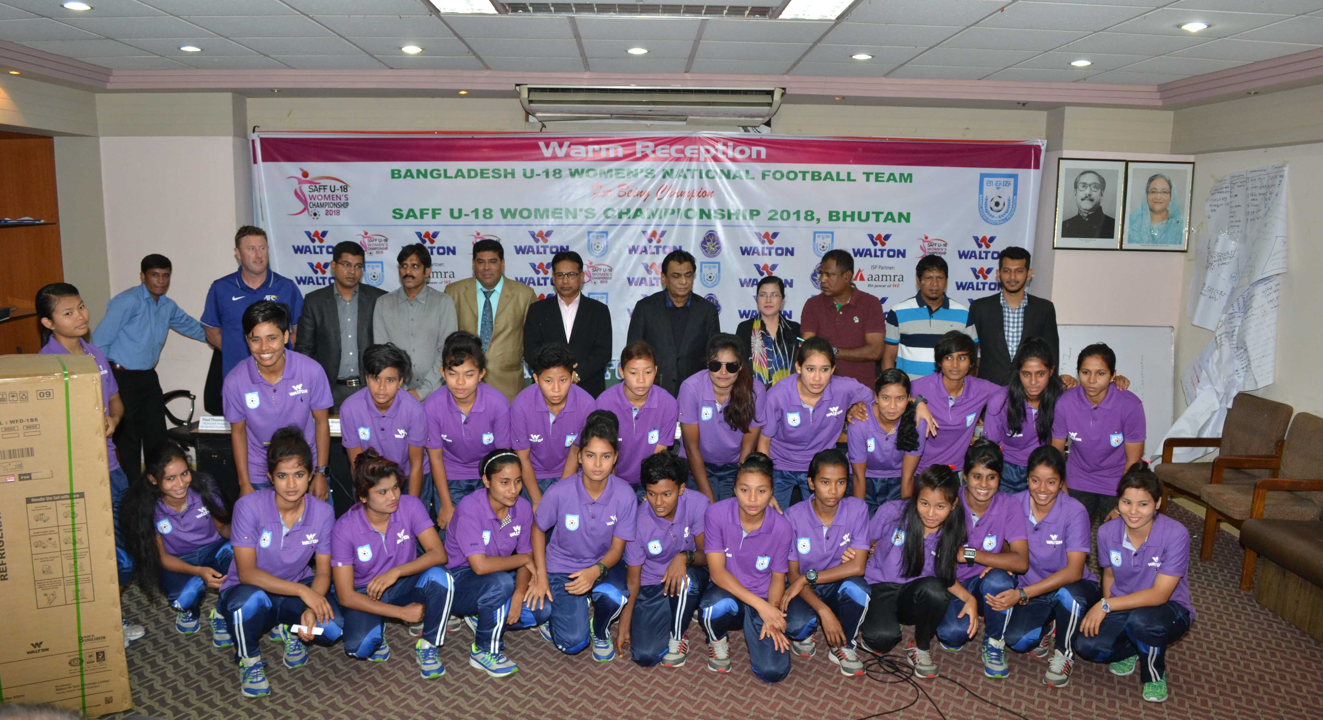 Members of Bangladesh Under-18 National Women's Football team with the guests and officials of Bangladesh Football Federation (BFF) pose for a photo session at the BFF House on Sunday. Walton Group accorded a reception to Bangladesh Under-18 National Women's Football team, which emerged as the champions of the SAFF Under-18 Championship in Bhutan recently.
