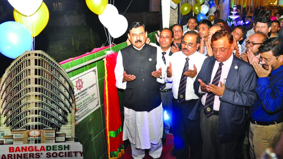Shipping Minister Shajahan Khan along with others offering munajat after laying foundation stone of the own building of Bangladesh Mariners' Society in the city's Baridhara area on Sunday night.