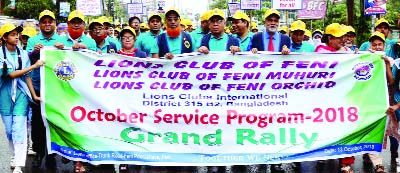 FENI:  Lions Club of Feni brought out a rally  from Feni Pourashava on the occasion of the October Service Programme on Saturday.