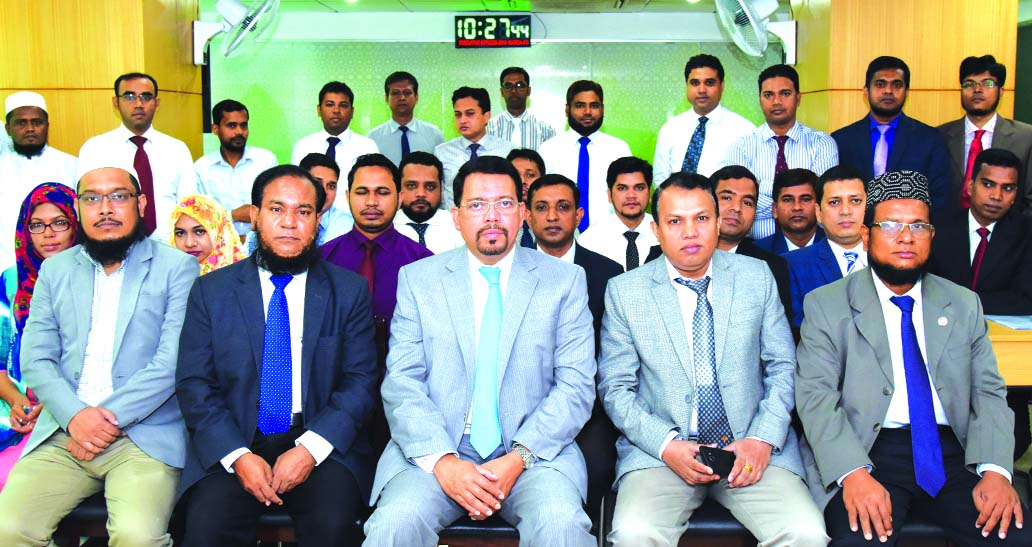 Farman R Chowdhury, Managing Director of Al-Arafah Islami Bank Ltd, poses with the participants of a day-day long training workshop on 'RMG Financing' at its Training and Research Institute on Monday. Principal of the Institute and Executive Vice President Md. Abdur Rahim Duary and Assistant Vice President Mujibur Rahman Rahman were also present in the ceremony.