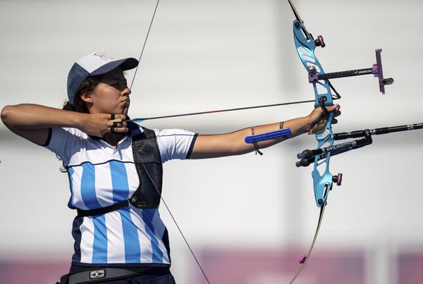In this photo provided by the OIS/IOC, Agustina Sofia Giannasio competes in the Semifinal of the Archery Mixed International Team Event at the Archery Range in Tecnopolis Park at the Youth Olympic Games in Buenos Aires, Argentina on Sunday.