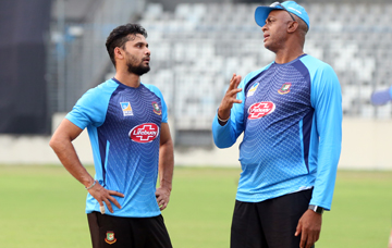 Coach of Bangladesh National Cricket team Courtney Walsh (right) talking to pacer Masheafe Bin Mortaza during the practice session of Bangladesh National Cricket team at the Sher-e-Bangla National Cricket Stadium in the city's Mirpur on Tuesday.
