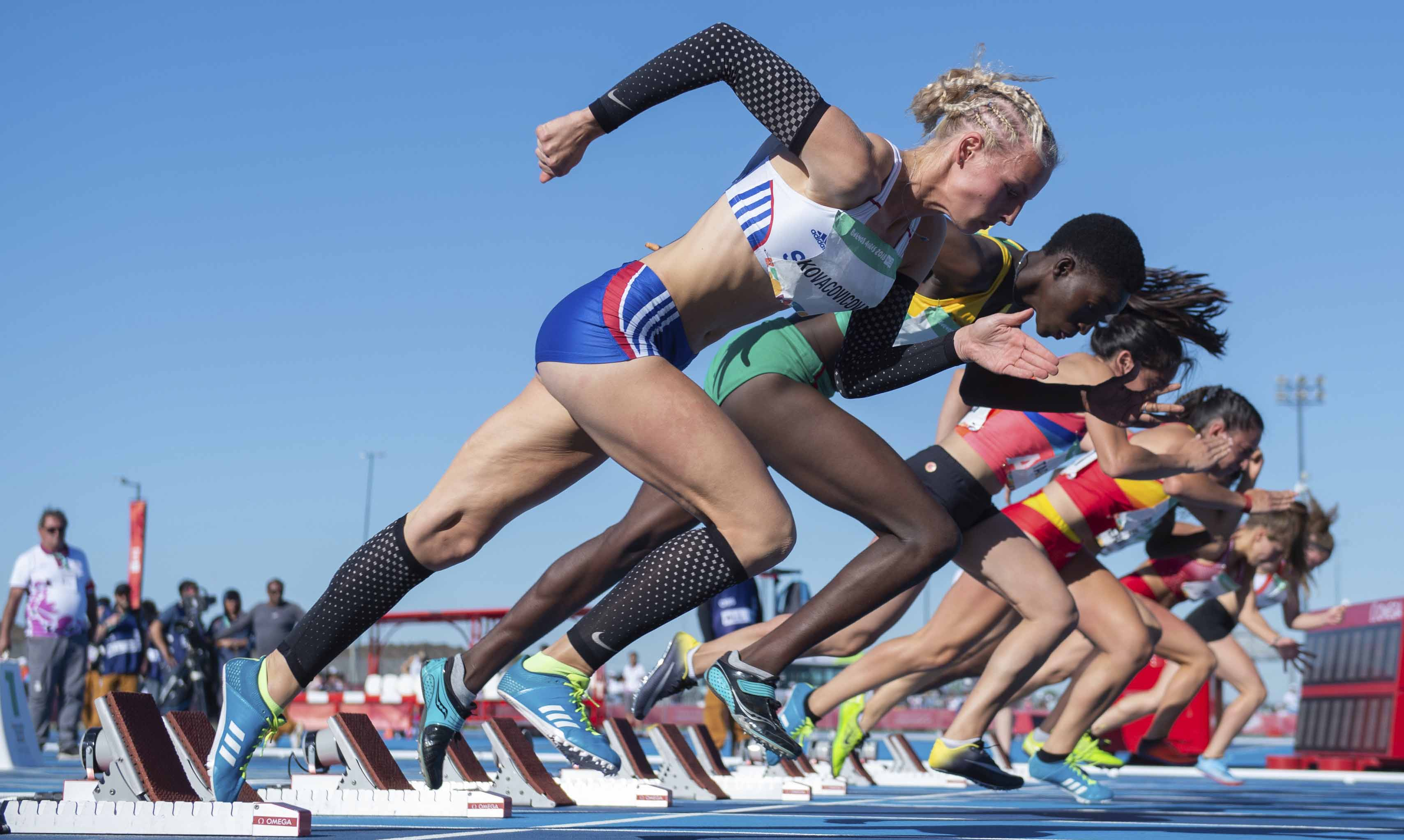 In this photo provided by OIS/IOC, Lenka Kovacovicova, of Slovakia (foreground) takes off at the start of the Athletics Women's 100-meter Stage 2 Heat 3, in Buenos Aires in Argentina on Monday.
