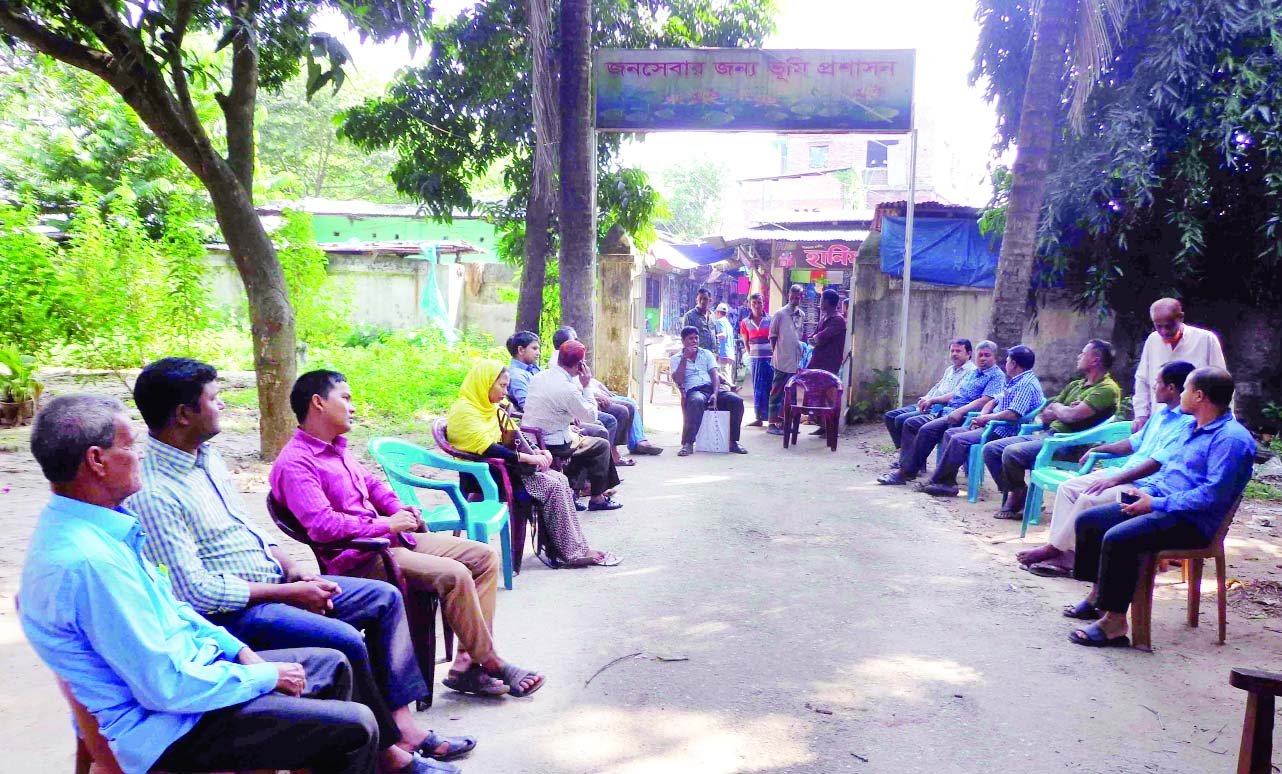 DINAJPUR (South): Staff of Fulbari  Poura Land Office observed a sit- in programme  at main gate of the office protesting assault of a office assistance by Upazila Parishad Chairman on Monday.