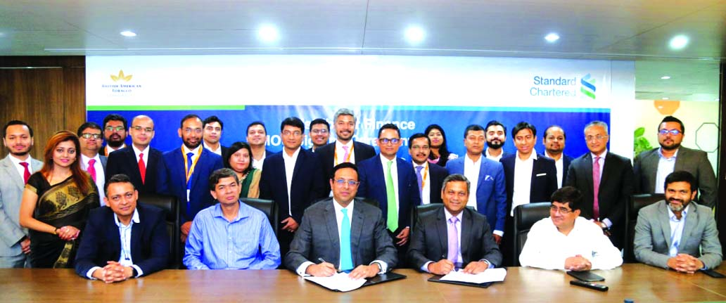 Shehzad Munim, Managing Director of British American Tobacco (BAT) Bangladesh and Naser Ezaz Bijoy, CEO of Standard Chartered Bangladesh, signing an agreement to avail the 'Supply Chain Finance' programme (a financing programme for the distributors and suppliers of Bank's corporate clients) at BAT head office in the city recently. Kanan Kumar Roy, Member, Iktiar Uddin Mohammed Mamun, First Secretary of Tax Policy of NBR and other senior officials from the two companies were also present.