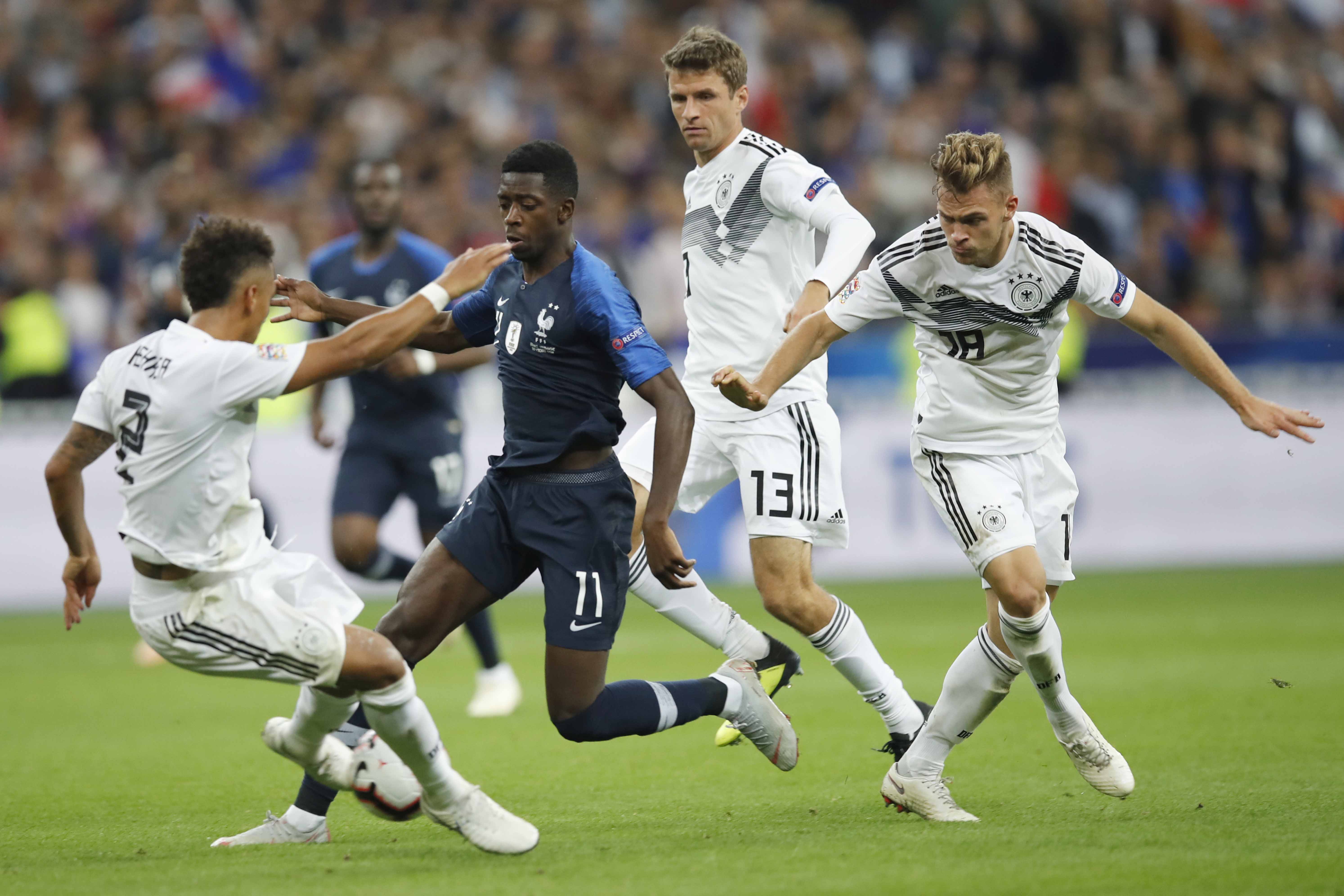 France's Ousmane Dembele (2nd left) challenges for the ball with German player, Thilo Kehrer (left) Thomas Mueller (2nd right) and Joshua Kimmich during a UEFA Nations League soccer match between France and Germany at Stade de France stadium in Saint Denis, north of Paris on Tuesday.