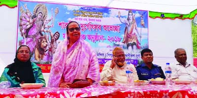 RAMPAL-MONGLA: Habibun Nahar MP speaking at a discussion meeting after visiting  Puja mandaps in Rampal Upazila  yesterday morning.
